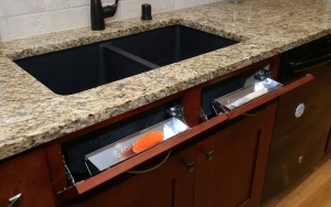 Rev-A-Shelf's Tip Out Trays are cut to size for each kitchen or bathroom remodel and conveniently hold sponges, soaps, and other frequently used hand or dishwashing items.